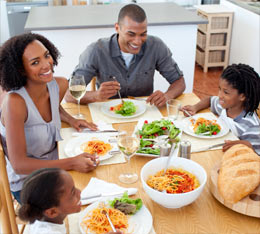 family-smiling-at-supper