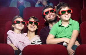 Family watching 3D movie together