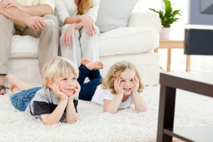 Parents with remote kids watching TV