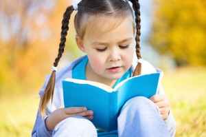 small child with a book