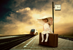 child waiting for a train