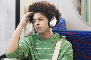 teen-boy-wearing-headphones-on-bus
