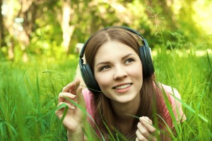 teen girl listening to headphones