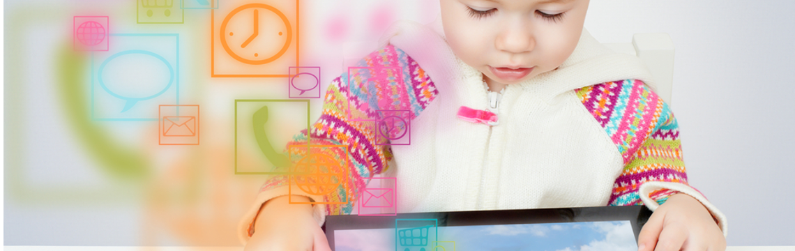 toddler playing with a tablet device