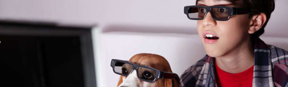 Child and dog wearing 3d glasses