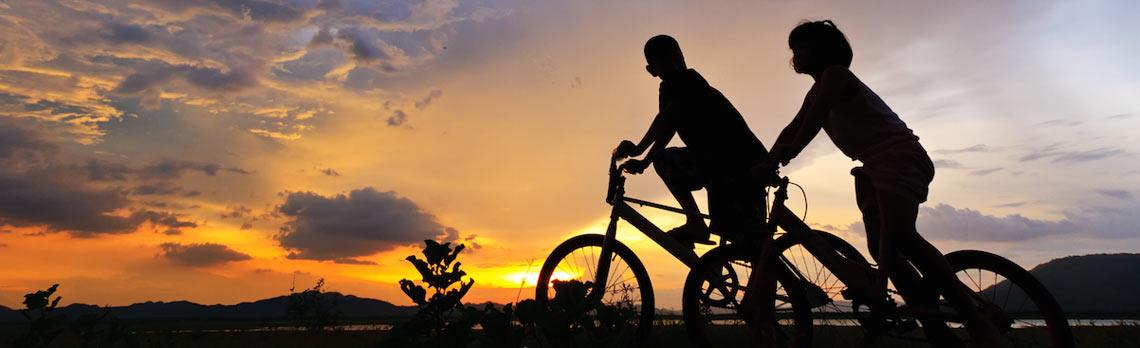 kids-on-bikes-at-sunset