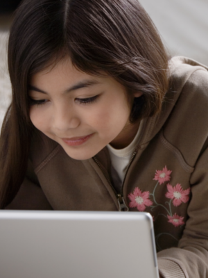 Tween girl using a laptop