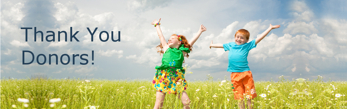 "Two children jumping in a field with the text ""Thank You Donors"""