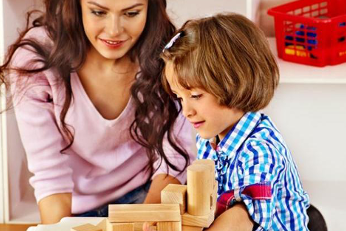 Woman and young girl playing with blocks
