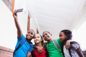 4 kids taking a selfie