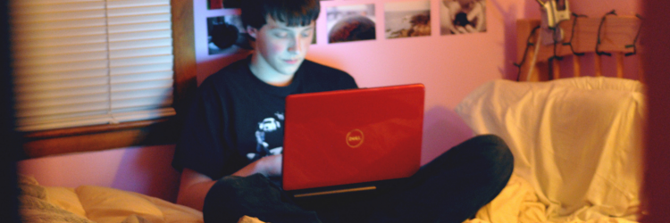 teen boy using laptop