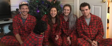 Four humans and a dog in matching holiday pajamas
