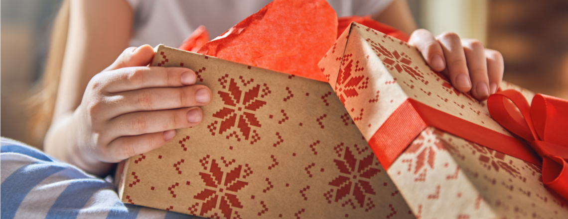 Close up of a girl's hands opening a present