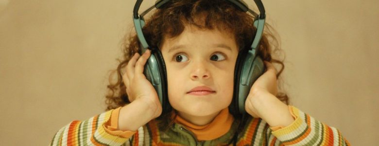 child with large headphones on