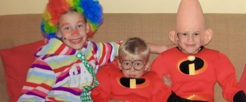 Three kids as clown and superheroes