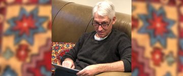 Joe Wolfson using a tablet