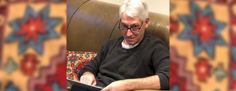 Joe Wolfson using a tablet