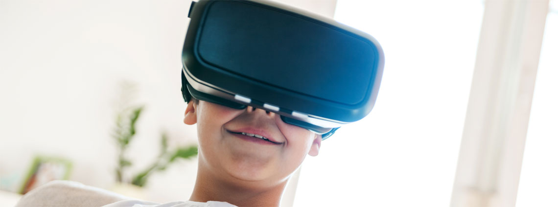 boy smiling with vr visor on